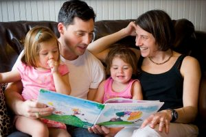 Family Reading Together --- Image by © Clare Marie Barboza/Corbis